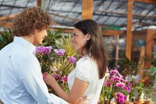 Free Couple Shopping In Garden Center Stock Image - 9958431