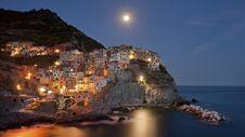 Free Coastal Town Illuminated At Night Stock Photography - 99545742