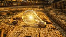 Free Light Bulb On Wood Background Royalty Free Stock Photography - 99545827