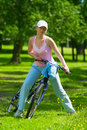 Free Woman Get Ride On The Bike Royalty Free Stock Image - 9961026