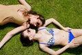 Free Girls In Beachwear Taking Sunbath On The Grass Royalty Free Stock Photography - 9966707
