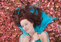 Free Young Woman Laying On Ground Covered With Petals Stock Photography - 9968152