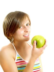 Free Smiling Girl With A Green Apple Royalty Free Stock Image - 9960216