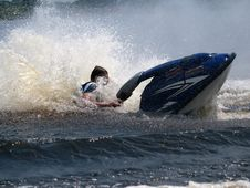 Free Man On Jet Ski In The Water Royalty Free Stock Photography - 9961957