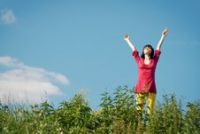 Free Girl On The Background Of Blue Sky. Stock Photo - 9962010