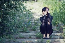 Free Fashionable Girl Sits On The Stair. Stock Photography - 9962112