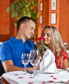The Man And The Fine Girl  At Restaurant. Stock Photos