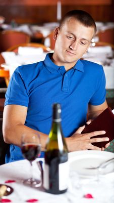 Free The Man  Looks At A Glass With Red Wine In Cafe Stock Photo - 9962800