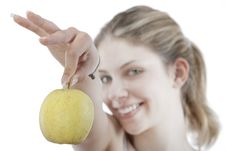 Free Young Woman Holding A  Apple Royalty Free Stock Image - 9963576