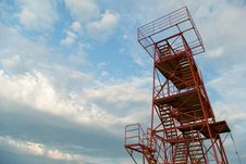 Free Red Metal Tower With Stairs Royalty Free Stock Image - 9964426