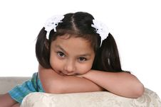 Free Pretty Multi Cultural Girl Resting On Arm Of Couch Royalty Free Stock Images - 9965369