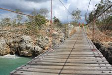 Free Old Wooden Hanging Bridge Over A Bay Stock Photo - 9966410