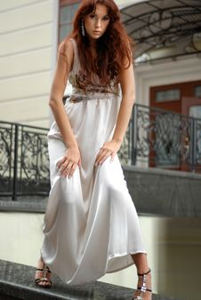 Free Woman In Long Dress Near A Hotel Stock Image - 9966491