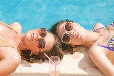 Free Girls Drkinking Cocktails On The Pool Stock Images - 9967224