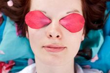 Young Woman With Pink Petals On Her Eyes Royalty Free Stock Image