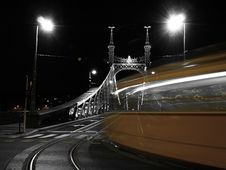 Free Tram Turning On To A Bridge Royalty Free Stock Photography - 9973587
