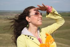 Free Wind And Beautiful Girl In Glasses Royalty Free Stock Image - 9975076