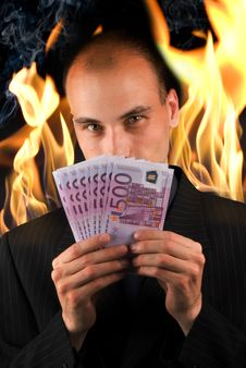 Free Businessman Holding Money Royalty Free Stock Photos - 9975638