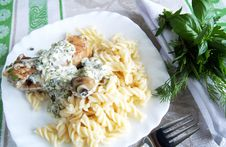 Chicken Legs With Pasta With Herbal Cream Sauce Royalty Free Stock Images