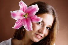 Free Young Woman Posing With A Pink Lily Royalty Free Stock Image - 9979446