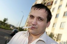Man With Cigarette Royalty Free Stock Photos