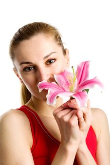 Free Nice Girl  With A Pink Lily Stock Photos - 9979573