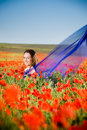 Free Smiling Girl In The Poppy Field Royalty Free Stock Photos - 9986598