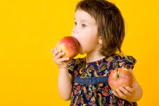 Little Girl With Two Apple Stock Image