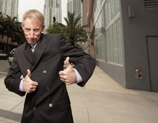 Free Mature Businessman With Thumbs Up Stock Images - 9984174