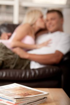 Free Young Couple On Sofa Stock Photography - 9985272