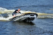 Free Young Man Riding Jet Ski Royalty Free Stock Images - 9986549