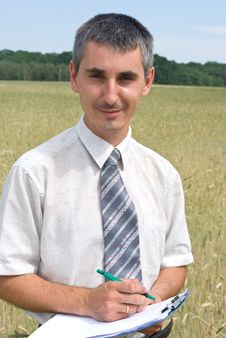 Man Inspecting The Wheat Stock Images