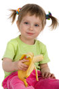 Free Little Girl Eats A Banana Royalty Free Stock Photos - 9990448