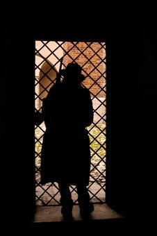 Free Silhouette Of A Tramp In The Back-light Royalty Free Stock Photography - 9992117