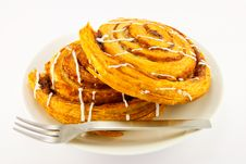 Free Two Cinnamon Buns And Fork Stock Photography - 9992532