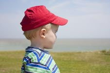 Free Boy Gazing Out To Sea Royalty Free Stock Photography - 9993507