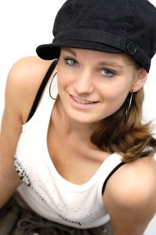 Young Woman With Black Cap Royalty Free Stock Photography