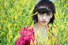Free Girl Is Against The Background Flowers. Stock Photos - 9997653