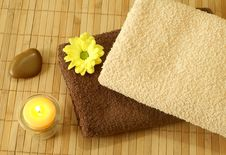Towels, Stone, Yellow  Flower And Candle Royalty Free Stock Photography