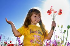 Free Little Girl Holding A Bunch Of  Poppy Stock Photos - 9997893