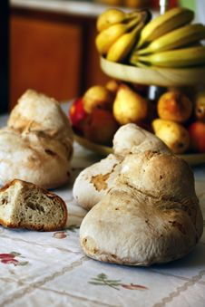 Several Breads And Bowl Of Fruit Royalty Free Stock Photo