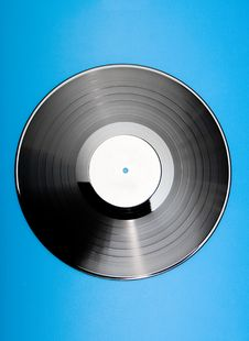 Free Vinyl Disc On Blue Background Stock Photo - 9999100
